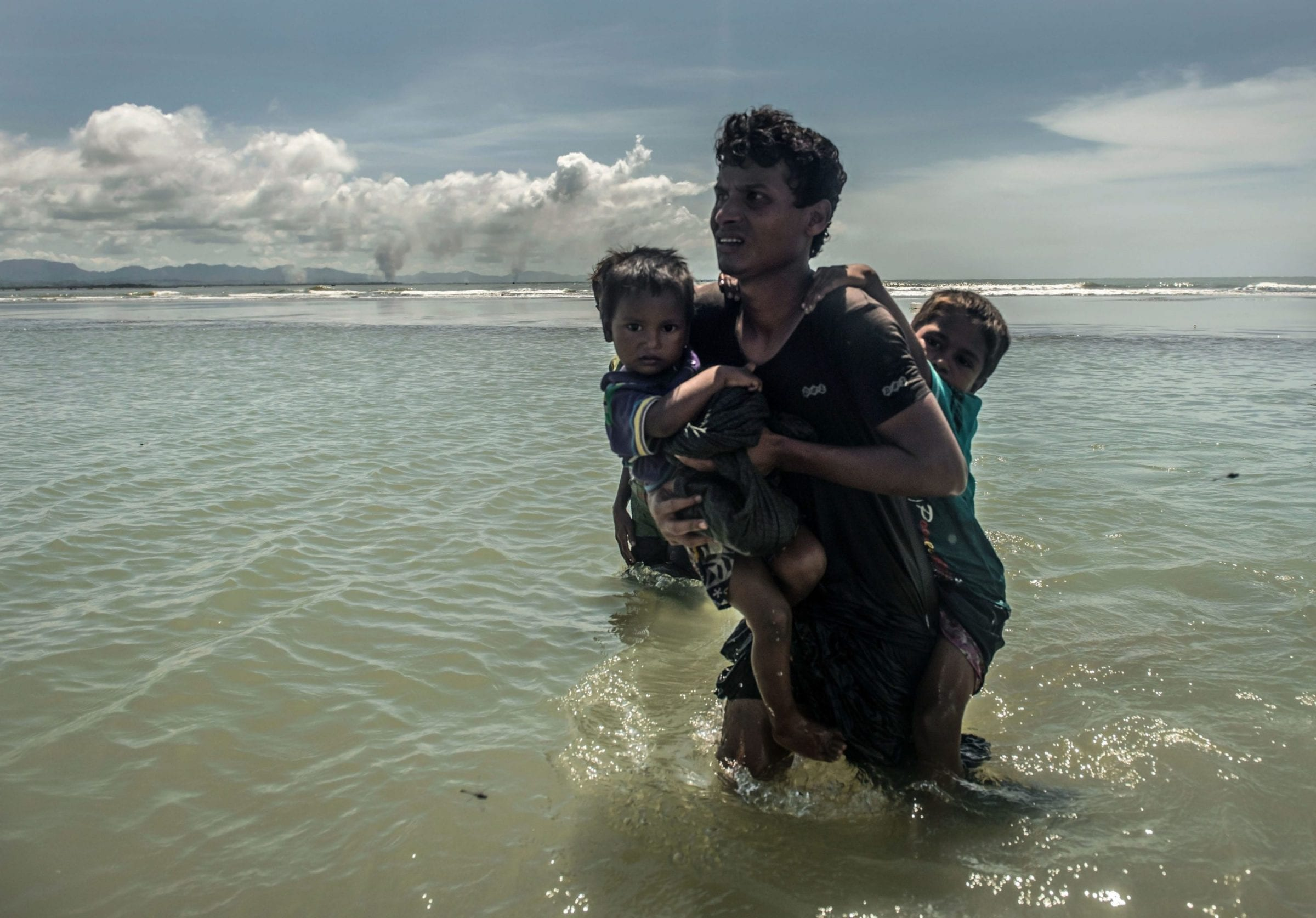 Rohingya refugees from Mongdu district in Myanmar arrive on the Bangladeshi island of Shah Porir Dwip after fleeing violence at home.
