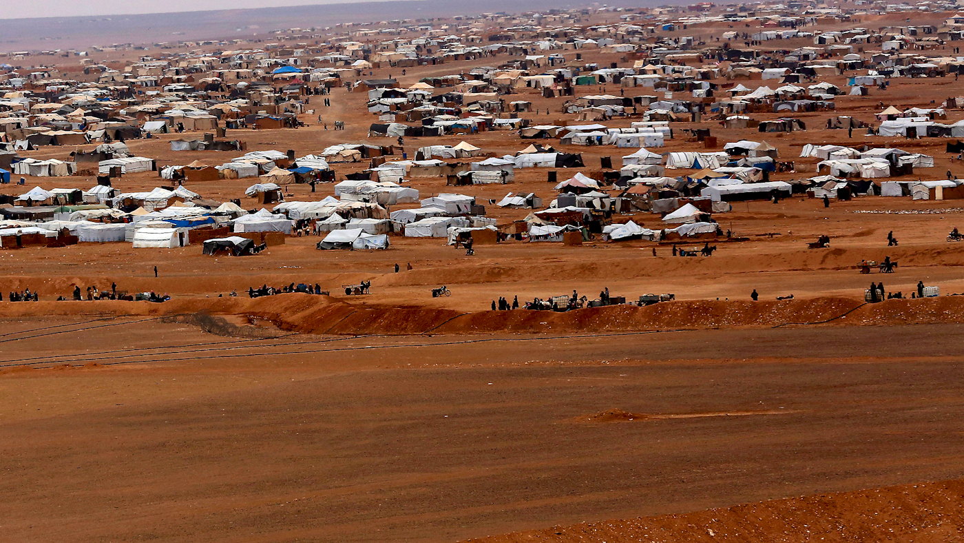 This Feb. 14, 2017 file photo, shows the informal Rukban camp for displaced Syrians, between the Jordan and Syria borders. Desperate to help Syrians stuck on Jordan's sealed border, U.N. agencies reluctantly agreed late last year to hand much of the control over aid distribution to Jordan's military, a Jordanian contractor and a Syrian militia. Since then, the system has broken down repeatedly and only sporadic aid shipments have reached the two remote desert camps on the border. (AP Photo/Raad Adayleh, File)