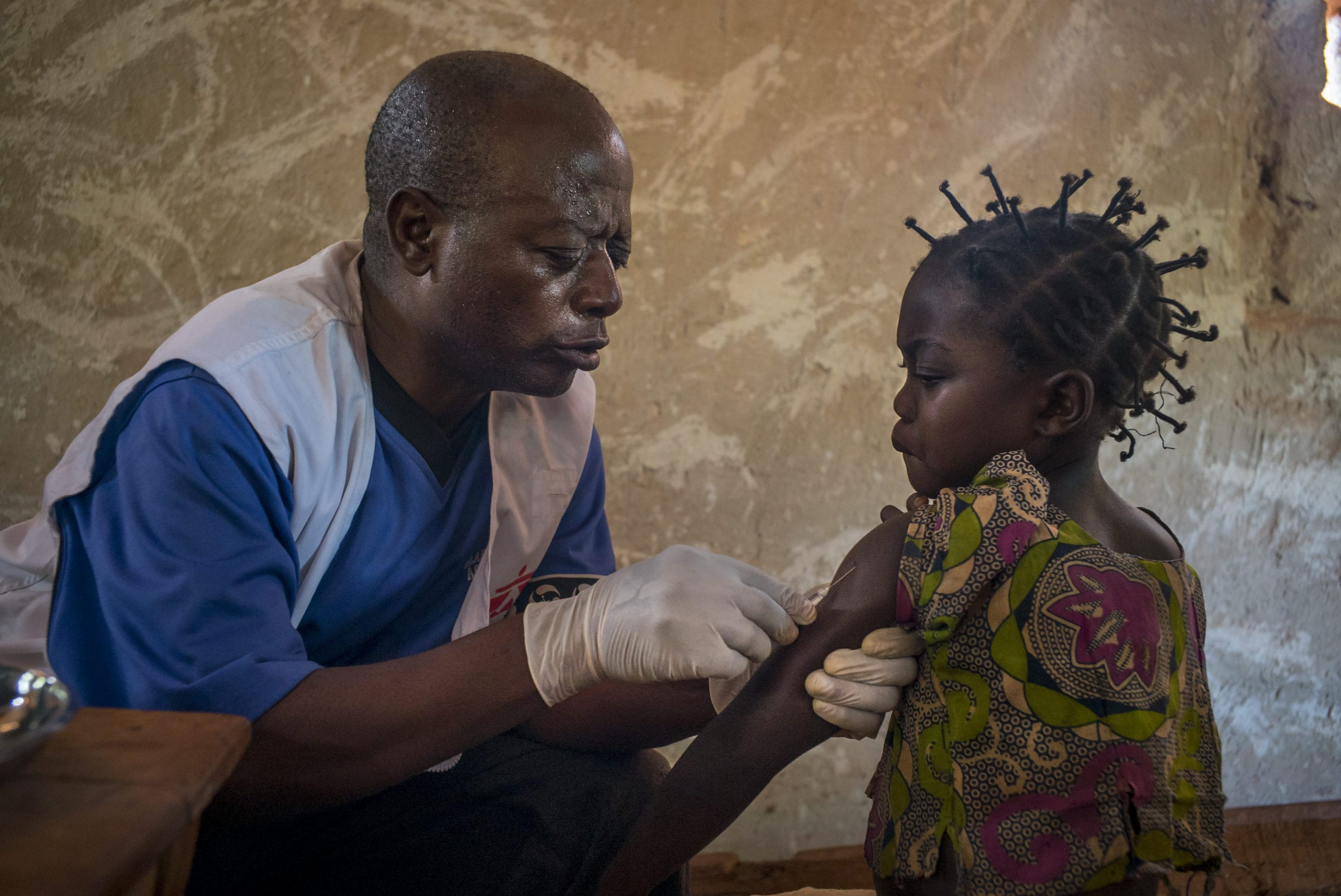 A young girl receives a measles vaccination on Day 1 of the vaccination campaign. Kolo, Bas-Uele Province, Democratic Republic of Congo.