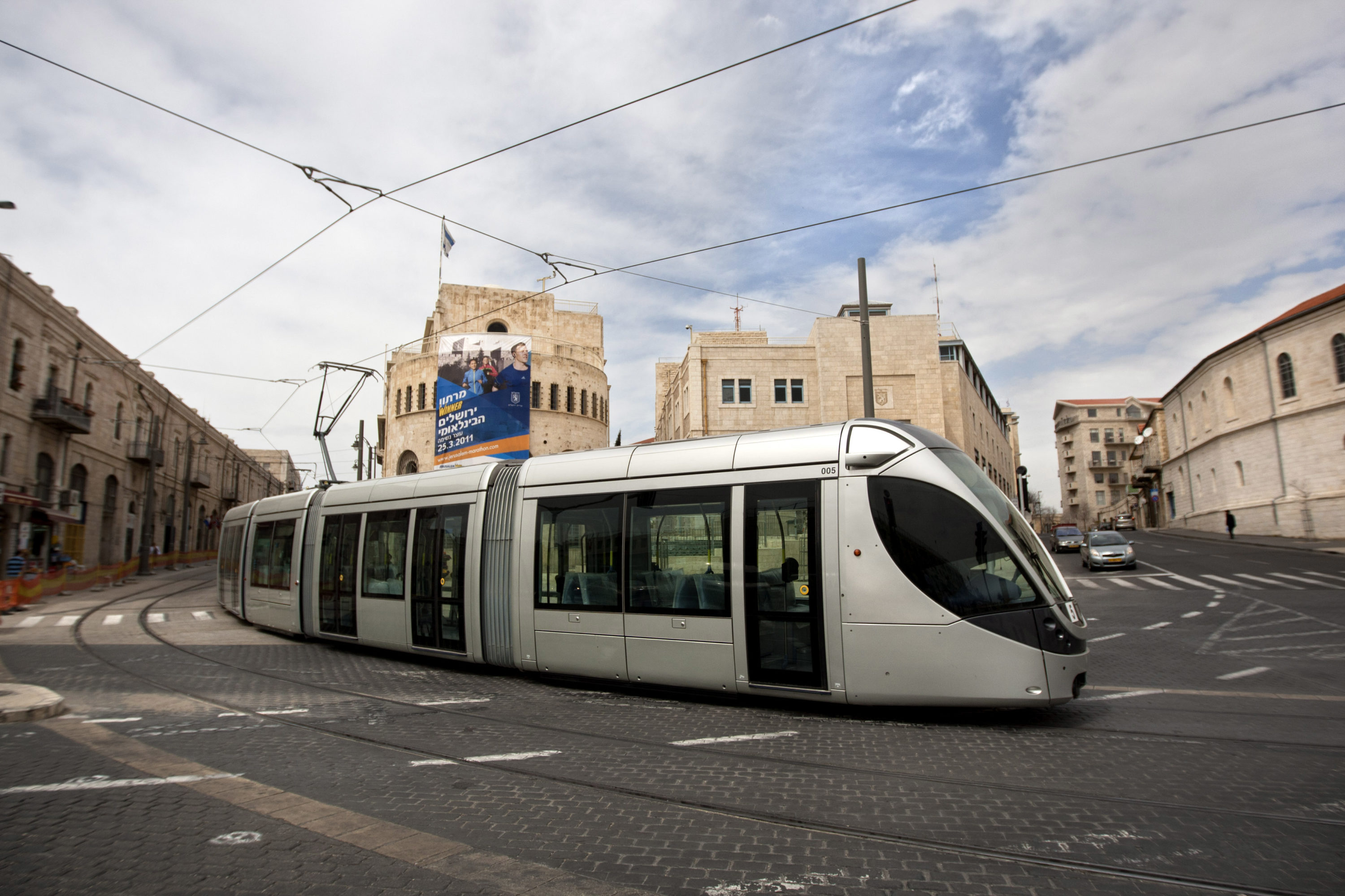 In this photo taken on Sunday, March 20, 2011, the new light rail is seen during trial runs in Jerusalem. After years of delays, Jerusalem's historic light rail is set to make its maiden voyage, completing a journey that has circumvented ancient bones, archaeological treasures, budget overruns and political potholes that have repeatedly threatened to derail the project. For its proponents, the rail system is a last-ditch effort to modernize one of the world's oldest cities. (AP Photo/Sebastian Scheiner)