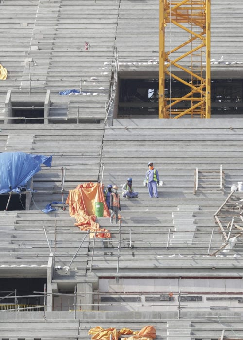 Workers work at Lusail Stadium, one of the 2022 World Cup stadiums, in Lusail, Qatar, Friday, Dec. 20, 2019. Construction is underway to complete Lusail's 80, 000-seat venue for the opening game and final in a city that didn't exist when Qatar won the FIFA vote in 2010. (AP Photo/Hassan Ammar)