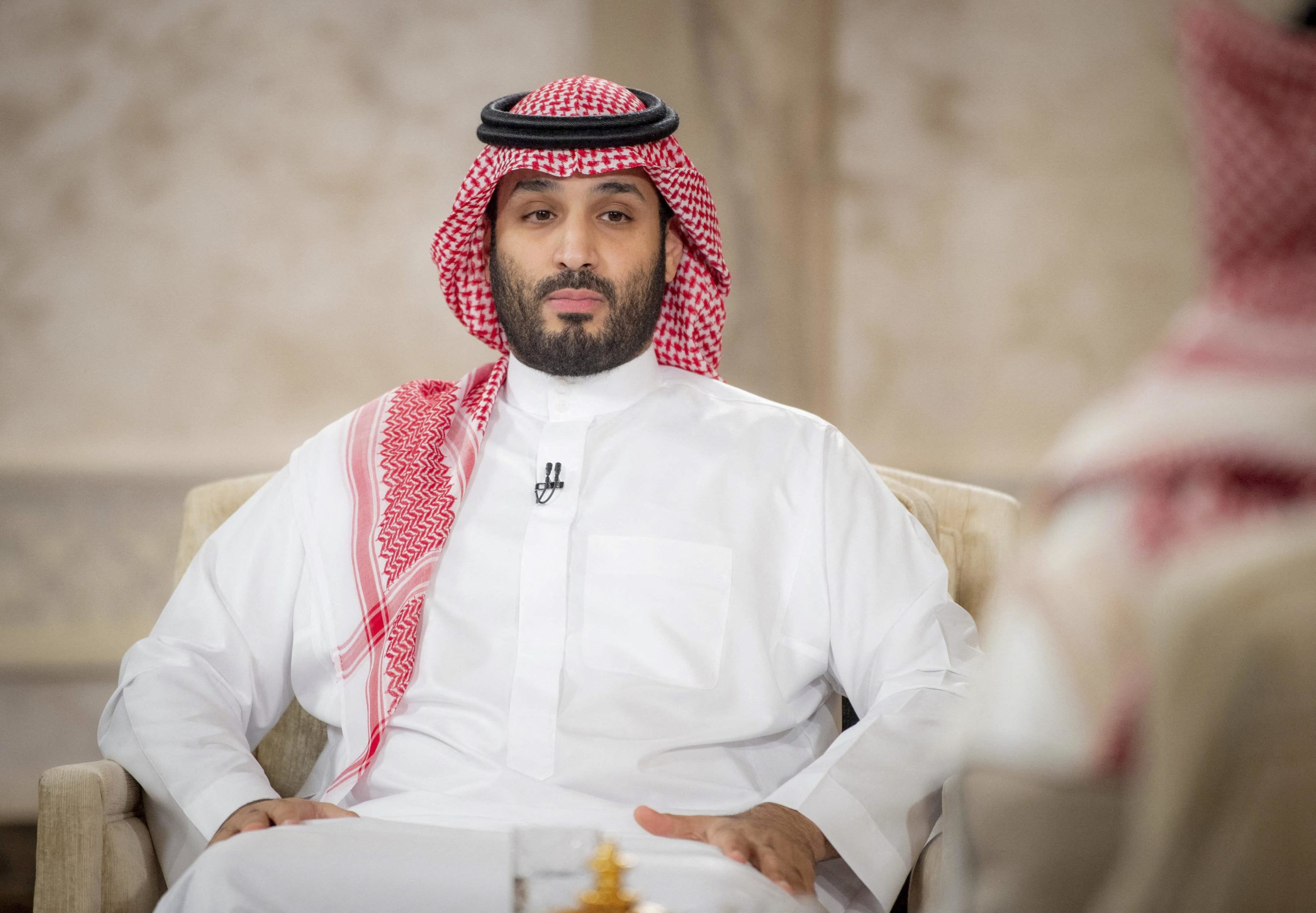(FILES) This handout picture provided by the Saudi Royal Palace on April 27, 2021, shows Saudi Crown Prince Mohammed bin Salman during an interview with the Middle East Broadcasting Center (MBC) in the capital Riyadh to mark the fifth anniversary of his vision 2030. - Two lawsuits pitting Saudi Arabia's de facto ruler against a former intelligence czar threaten to expose highly sensitive US government secrets, prompting Washington to consider a rare judicial intervention, documents show. (Photo by Bandar AL-JALOUD / Saudi Royal Palace / AFP) / RESTRICTED TO EDITORIAL USE - MANDATORY CREDIT